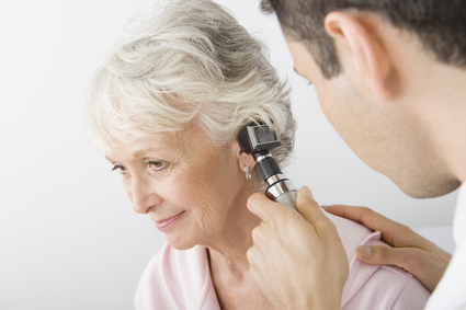 Doctor Examining Patient's Ear Using Otoscope In Clinic